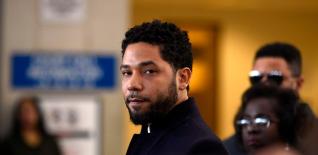 This March 26, 2019 file photo shows actor Jussie Smollett before leaving Cook County Court after his charges were dropped in Chicago.