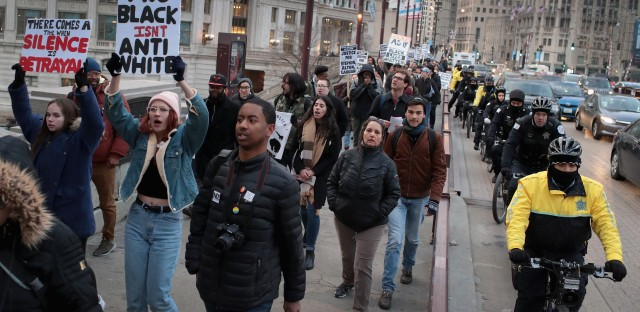 In recognition of the 50th anniversary of the death of the Rev. Martin Luther King Jr., and in solidarity with the family and supporters of Stephon Clark and others killed by police, demonstrators protest and march in the Magnificent Mile shopping district on April 2, 2018 in Chicago.