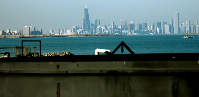 The BP Whiting Refinery is located in northwest Indiana on the shore of Lake Michigan, 20 miles southeast of Chicago, Ill. Here, a portion of tank at the BP waste water treatment plant is shown at the bottom with the Chicago skyline in the background.