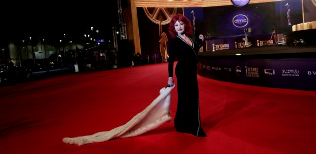 "In this Nov. 21, 2017 file photo, Egyptian actress Nabila Ebeid smiles on the red carpet during the opening of the 39th Cairo International Film Festival in Egypt. Egyptian police raided a tiny alternative film venue in Cairo the week prior to prevent the screening of ""The Nile Hilton Incident."" The movie highlights Egyptian authorities' obsession with censorship."