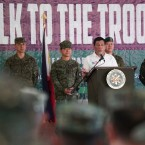 Philippine President Rodrigo Duterte, third right, talks to troopers during his visit in Jolo, Sulu province, Mindanao, southern Philippines.