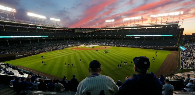 Fans sit in the bleachers at Wrigley Field as they wait before Game 1 of baseball's National League Division Series between the Chicago Cubs and the San Francisco Giants, Friday, Oct. 7, 2016, in Chicago.