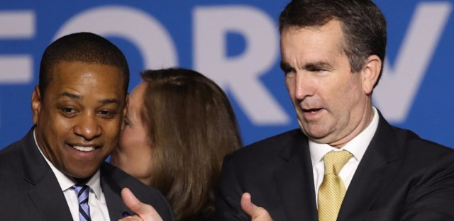 Virginia Gov.-elect Ralph Northam gives two thumbs up on stage with Lt. Gov.-elect Justin Fairfax, as they greet supporters at an election night rally Tuesday.