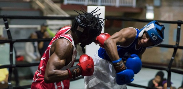 Partially blind fighter Kyron Brown (in blue) of Chicago will compete in a championship match in the Chicago Golden Gloves tournament Thursday in Cicero.