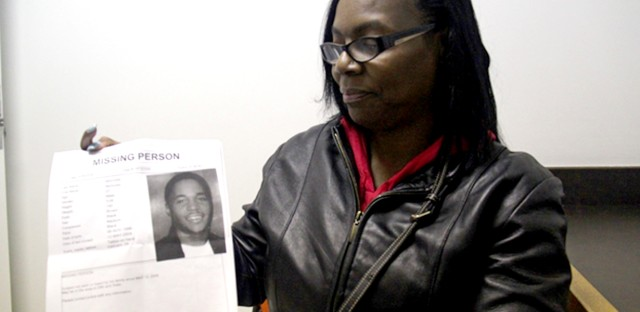 Renee Brown holds a missing persons document of her son Nicholas Brown, who disappeared in 2008.