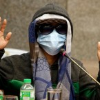 An eyewitness gestures during a senate investigation on the death of Kian Loyd Delos Santos, a 17-year-old student who was killed in an alleged drug crackdown, Tuesday, Sept. 5, 2017, at the Philippine Senate in Manila, Philippines.
