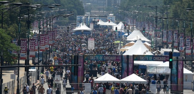 People fill Columbus Ave. while attending the Taste of Chicago to browse local food in Chicago's Grant Park, Thursday, July 6, 2017. The 2019 Taste of Chicago is from July 10 through July 14.