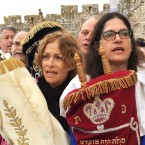 Members of Women of the Wall, which lobbies for women to be allowed to sing and pray aloud at the Western Wall, march through the Jewish quarter of Jerusalem's Old City. The group organizes monthly marches and are often heckled by ultra-Orthodox men.