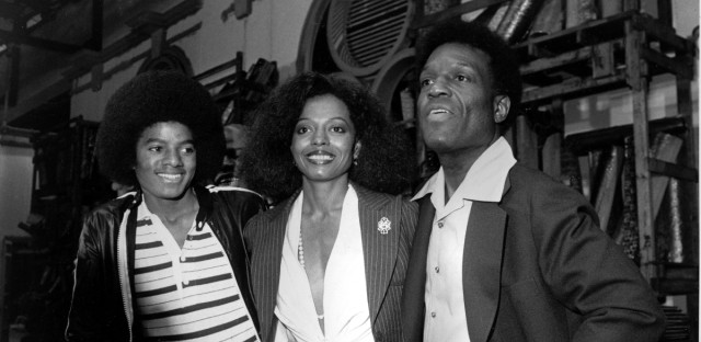 "Diana Ross, center, poses with co-stars Michael Jackson, left, and Nipsy Russell at a news conference for ""The Wiz"" in New York City on Sept. 28, 1977. Ross will play Dorothy, Jackson will portray Scarecrow, and Russell will play Tinman in the film version of the musical which was based on ""The Wizard of Oz."""