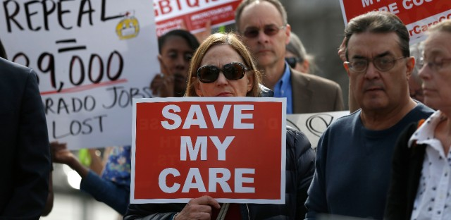Supporters of the Affordable Care Act, who are also opponents of Colorado's GOP-led plan to undo Colorado's state-run insurance exchange gather for a rally organized by the national Save My Care Bus Tour, on the state Capitol steps in Denver, Tuesday, Feb. 7, 2017. A bill being heard in the Senate Finance Committee Tuesday would abolish the state-run health insurance exchange.