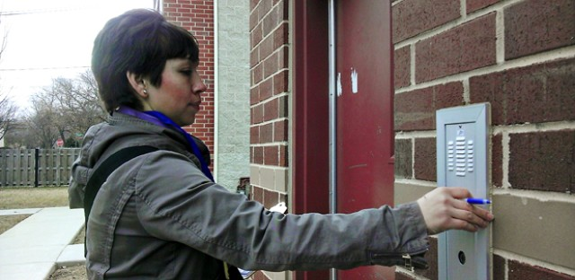 A parent volunteer with Stand for Children knocks on doors. The education nonprofit has been canvassing Chicago neighborhoods amid CPS closings.