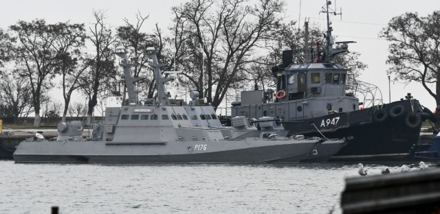 Three Ukrainian ships are seen as they docked after been seized ate Sunday, Nov. 25, 2018, in Kerch, Crimea, Monday, Nov. 26, 2018. The Ukrainian parliament is set to consider a presidential request for the introduction of martial law in Ukraine following an incident in which Russian coast guard ships fired on Ukrainian navy vessels.