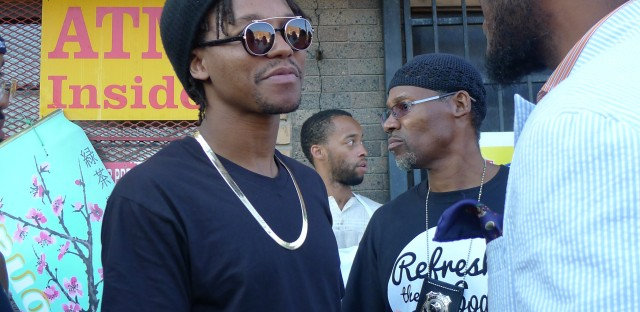 Hip-hop artist Lupe Fiasco outside of a corner store in Englewood.
