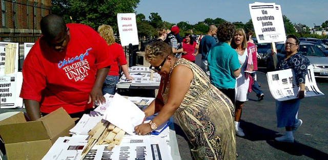 Chicago teachers pick up picket signs outside Wednesday's House of Delegates meeting.