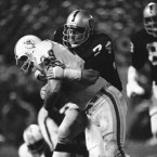 Dave Pear of the Oakland Raiders puts a stop to Larry Csonka of the Miami Dolphins after a one yard gain during fourth quarter action on Oct. 9, 1979 in Oakland. Raiders won 13-3.