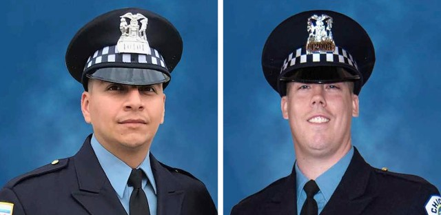Officers Eduardo Marmolejo (left) and Conrad Gary