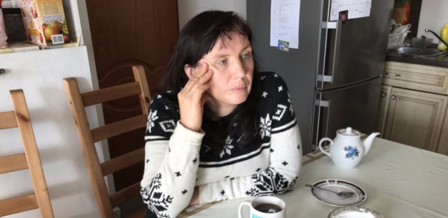 """Alyona Sadikova sits in the kitchen of the women's shelter she heads on the outskirts of Moscow. """"We try to get women back on their feet. This is not a hotel,"""" she says. """"We're not saviors, we want women to save themselves."""""""