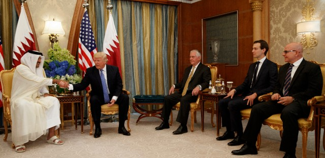 U.S. President Donald Trump, second left, shakes hands with Qatar's Emir Sheikh Tamim Bin Hamad Al-Thani, left, during a bilateral meeting, Sunday, May 21, 2017, in Riyadh. Seated with them are: U.S. Secretary of State Rex Tillerson, third right, White House senior adviser Jared Kushner, second right, and U.S. National Security Adviser H.R. McMaster