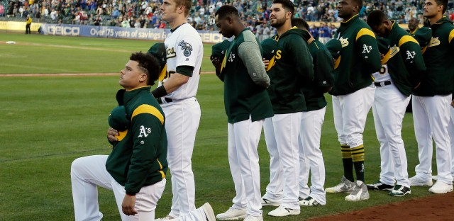 Oakland Athletics catcher Bruce Maxwell become the first major league baseball player to kneel during the national anthem a the start of a game against the Texas Rangers on Saturday in Oakland, Calif.