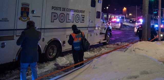 Police officers respond to a shooting in a mosque at the Quebec City Islamic Cultural Centre in Quebec City on Sunday.