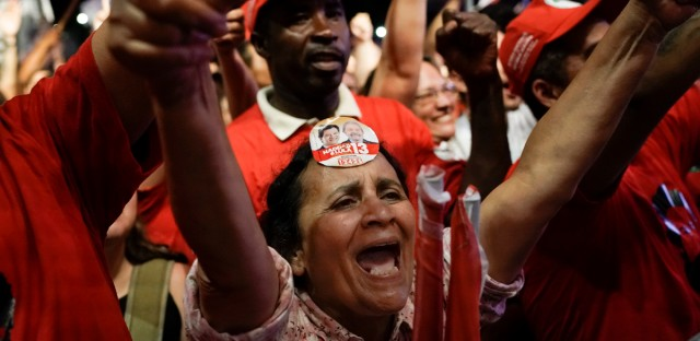 A supporter of Brazil's former president Luiz Inacio Lula da Silva and presidential candidate for the Workers Party, Fernando Haddad, wears a sticker of the two men on her forehead during a campaign event in downtown Rio de Janeiro, Brazil, Monday, Oct. 1, 2018. Haddad was hand-picked by Brazil's jailed, former President Luiz Inacio Lula da Silva to be their party's candidate in the Oct. 7 general elections.