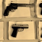 Image of guns lying on a table