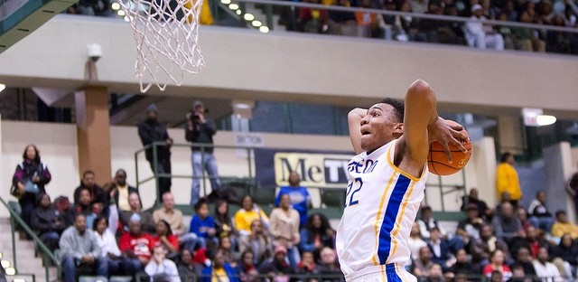 Senior Jabari Parker goes up for a dunk in front of a packed gym