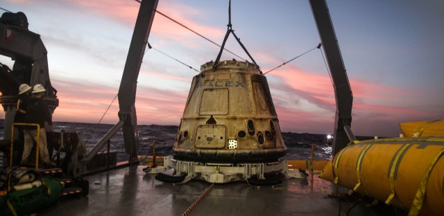 SpaceX regularly flies and returns cargo capsules like the one pictured here to the International Space Station. Now the company says a modified version could take customers to the moon.