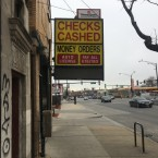 A currency exchange sits at Roosevelt and Western on Chicago's West Side.