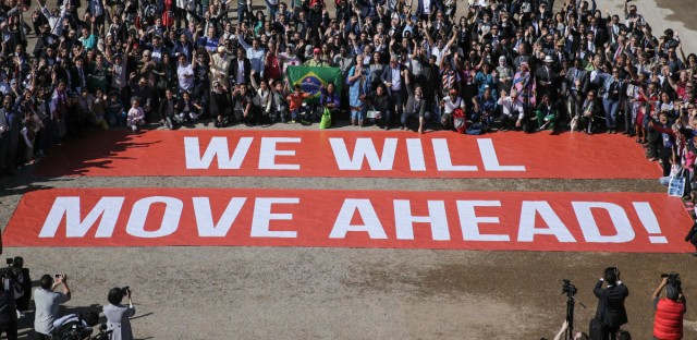 Participants at the COP22 climate conference stage a public show of support for climate negotiations and Paris agreement, on the last day of the conference, in Marrakech, Morocco, Friday, Nov. 18, 2016. (AP Photo/David Keyton)