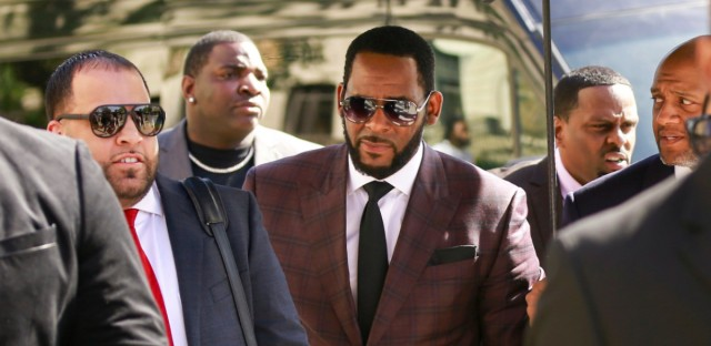 R&B singer R. Kelly, center, arrives at the Leighton Criminal Court building for an arraignment on sex-related felonies Wednesday, June 26, 2019 in Chicago.