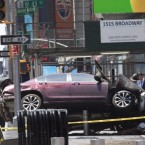 A car rests on a security barrier in New York's Times Square