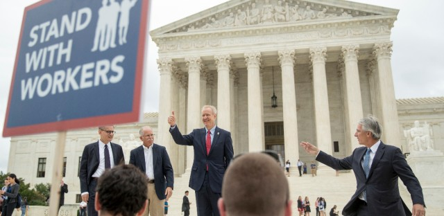 From left, Liberty Justice Center's Director of Litigation Jacob Huebert, Illinois Gov. Bruce Rauner, Liberty Justice Center founder and chairman John Tillman, and plaintiff Mark Janus walk out of the the Supreme Court after the court rules in a setback for organized labor that states can't force government workers to pay union fees in Washington, Wednesday, June 27, 2018.