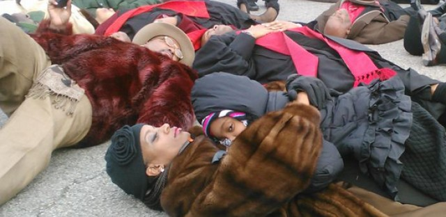 A mom and daughter at a die-in near 39th and Cottage Grove on Sunday. Some demonstration organizers say the Chicago Police Department is monitoring their phone calls.