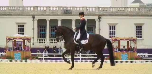 Dressage rider Edward Gal of the Netherland and his horse Undercover, prancing.
