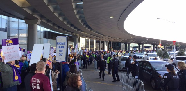 Hundreds were in front of terminals with signs, chanting for O'Hare airport service workers strike.
