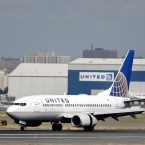 A United Airlines passenger plane lands at Newark Liberty International Airport in Newark, N.J. Twitter users are poking fun at United's tactics in having a man removed from an overbooked Chicago to Louisville flight on April 9, 2017.