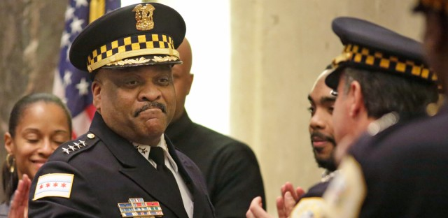 Chicago Police Superintendent Eddie Johnson, left, shakes hands with officers at an April 13, 2016, city council meeting in Chicago. Johnson leads a police force that has expanded by 376 new cops in the past year.