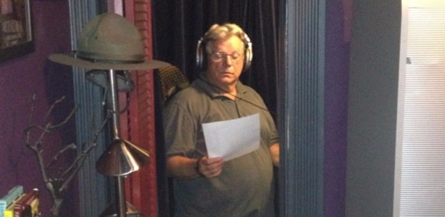 Voice-over artist Norm Woodel poses inside the closet-turned-home studio in Lakeview where he has read political ads for politicians such as Hillary Clinton and President Barack Obama.