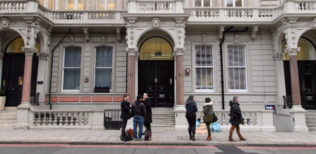 Journalists gather outside the London headquarters of Orbis Business Intelligence, the company co-owned by former British intelligence officer Christopher Steele, on Thursday.