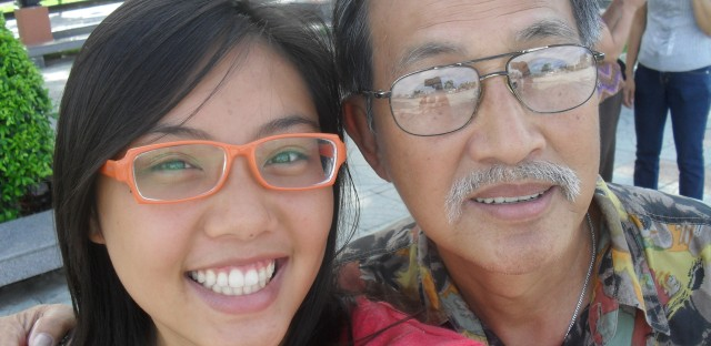 Tien Dang takes a selfie with her father, Nam.