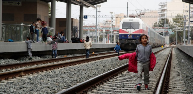 A migrant boy walks on the tracks at Larissis rail way central station in Athens, Friday, April 5, 2019. Protesting migrants in Greece have blocked Athens' main train station and disrupted rail services, apparently prompted by false reports on social media that restrictions on travel to northern Europe had been lifted.