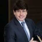 Former Illinois Gov. Rod Blagojevich smiles as he arrives at the federal building in Chicago, Wednesday, July 7, 2010, for his corruption trial.