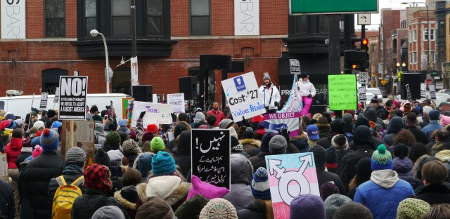 Hundreds gathered in a parking lot on Roscoe and Halsted streets to rally in support of transgender rights on Saturday afternoon.