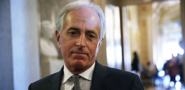 "Sen. Bob Corker, R-Tenn., speaks to media at the Capitol on Dec. 1. Although Corker had voted against the Senate's original version of the tax bill, he says now he has changed his mind after ""great thought and consideration."" Alex Wong/Getty Images"