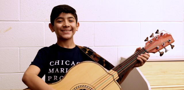Carlos Vilchis' guitarrón is almost as big as he is. Vilchis is a student in the Chicago Mariachi Project's Mariachi Academy, held each Saturday at Benito Juarez Community Academy.