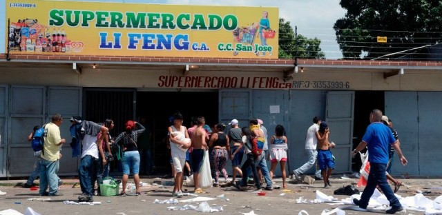 The helicopter incident in Caracas capped a volatile 24 hours that began with widespread looting in the coastal city of Maracay on Monday night.