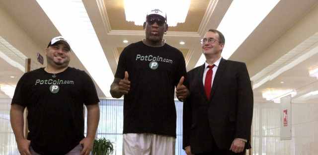 Former NBA basketball star Dennis Rodman, poses with his entourage after arriving at Sunan International Airport in Pyongyang, North Korea, Tuesday. It's Rodman's first visit to North Korea since President Trump took office. (Kim Kwang Hyon/AP)