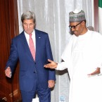 In this photo released by the Nigeria State House, U.S. Secretary of State John Kerry, left, talks to Nigeria's President Muhammadu Buhari, before their bilateral talks at the State House in Abuja, Nigeria, Tuesday Aug. 23, 2016. Kerry arrived Tuesday in Nigeria to hold talks with leaders of the West African nation that are expected to focus on regional security and extremism.