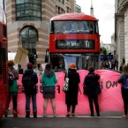 Extinction Rebellion climate change protesters briefly block a road near the Bank of England in the City of London, Thursday, April 25, 2019. Extinction Rebellion says it will end its remaining blockades in London on Thursday evening with a closing ceremony, after disrupting the British capital for 10 days. The non-violent protest group is seeking negotiations with the government on its demand to make slowing climate change a top priority.